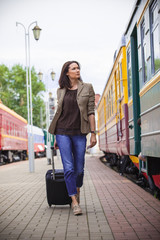 beautiful adult woman with suitcase