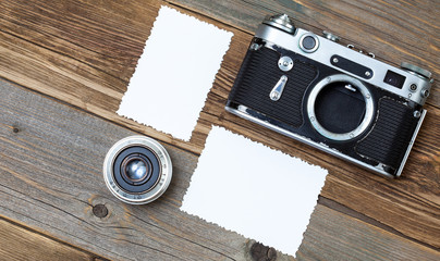 retro photo mock up, vintage camera and lens on old wooden background