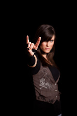Young Rocker Woman Giving Sign of the Horns - Rock Musician