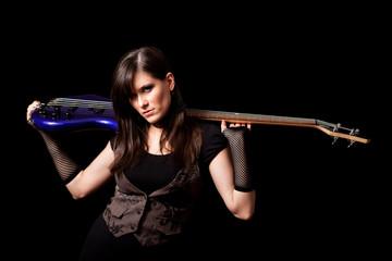 Young Rocker Woman Holding Bass Guitar - Rock Musician Guitarist
