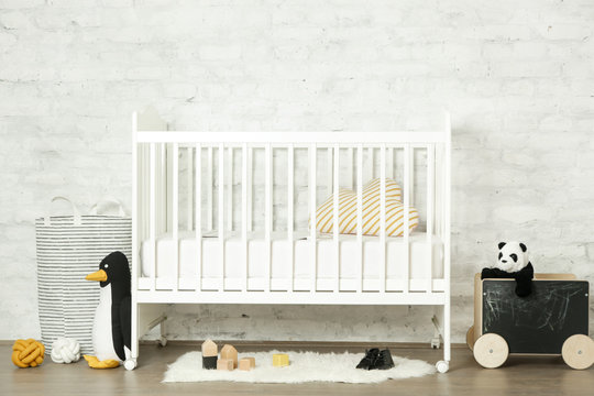 White wooden crib in a baby room