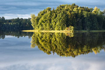 A lake, perfect reflection, clouds, and forest