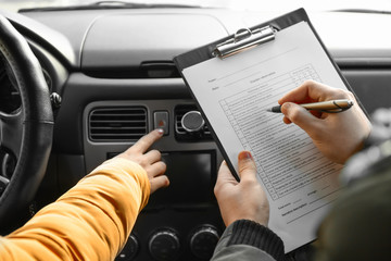 Young woman passing driving license test
