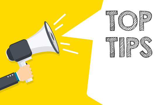 Top Tips speech bubble. Hand holding megaphone with Top Tips text. Hand holding megaphone with open space for your text.