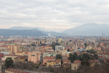 Brescia cityscape with snow covered mountains on background, Lombardy, Italy.