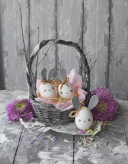 Easter decoration for home, handmade work, cute eggshell rabbit in a basket