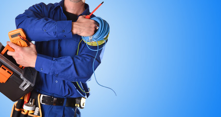 Electrician with tools and electrical equipment isolated blue detail