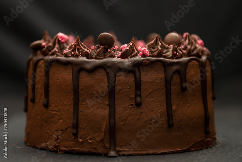side view of a rich dark chocolate birthday cake