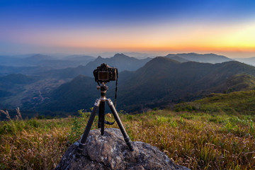 Digital camera on tripod in the mountains.