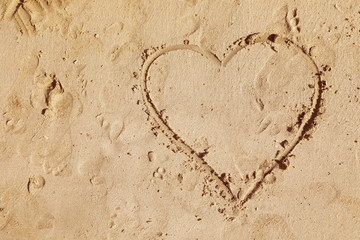 Drawing of heart on sandy surface, top view with space for text