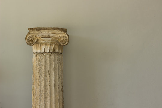 antique marble column from ancient Greece times exhibit object on white wall background texture with empty copy space for your text or inscription