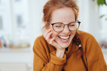 Pretty red-haired girl laughing portrait