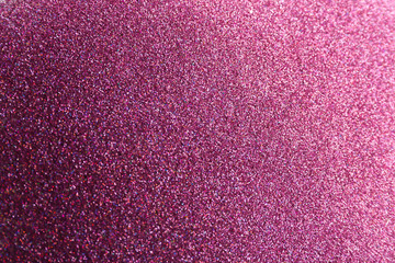 Closeup view of sparkling violet glitter background