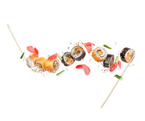 In de dag Sushi bar Fresh different sushi rolls with ginger frozen in the air on white background