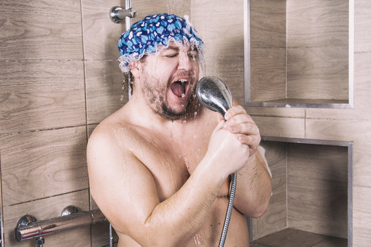 Funny fat man sings in the shower.
