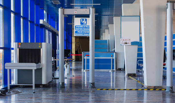security checkpoint with scanner machines are scanning luggages