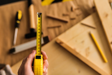 Carpenter with tape measure tool