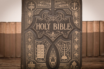 Vintage Bible with Books on an Old Wooden Trunk