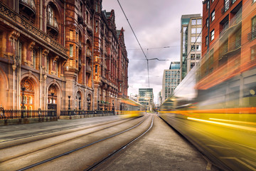 Pair of tram light trails at St Peter's Square, Manchester, England.