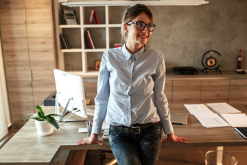Portrait of mid age business woman.She standing in her office.