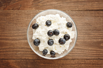 Top view close-up of curd and blueberries wooden background, healthy Breakfast