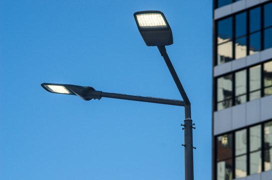 A modern street LED lighting pole. Urban electro-energy technologies. Savings on street urban road lighting.