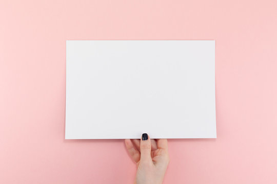 Woman hands with blank A4 paper sheet mockup