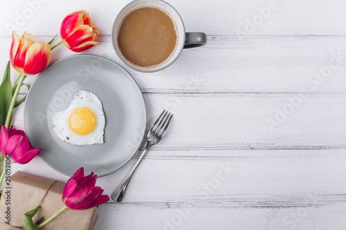 Mother's day composition.Breakfast with tulips on white background.