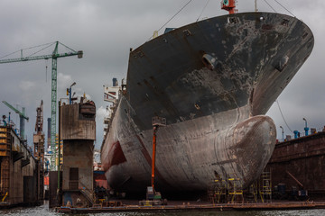 Gdansk shipyard with monumental bow of cargo ship.