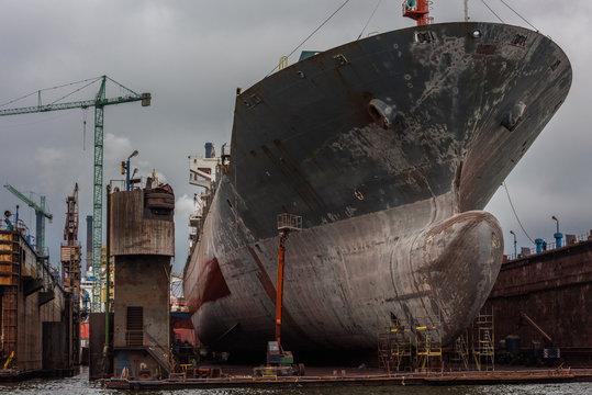 Gdansk shipyard with monumental bow of cargo ship.