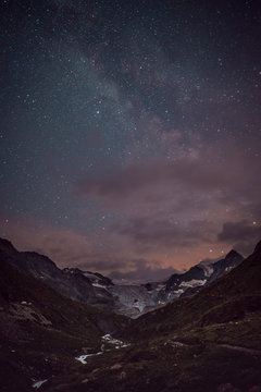 Idyllic view of mountain ranges against star field at night