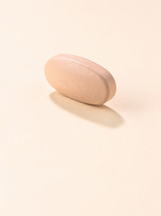 High angle view of medicine on beige background