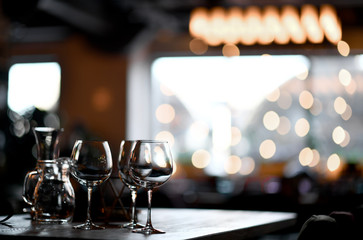 Blurred background in restaurant interior  details in blurred bokeh focus on empty wine glasses