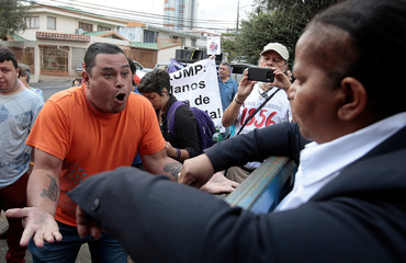 Norma Borges, representative of the government of Nicolas Maduro, argues with a supporter of Venezuela's opposition leader Juan Guaido, after Guaido's designated ambassador to Costa Rica Maria Faria took control of Venezuela's embassy, in San Jose