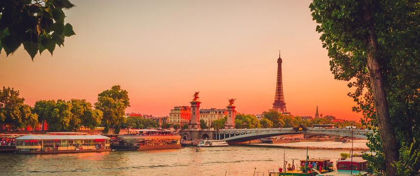 Sunset view of  Eiffel Tower, Alexander III Bridge and river Seine in Paris, France.
