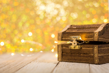 Treasure Chest for St. Patrick's Day, Spring, Wealth, Luck, on beautiful gold bokeh background, room for text and copy