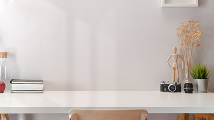 Contemporary minimal workspace with white wooden table and copy space