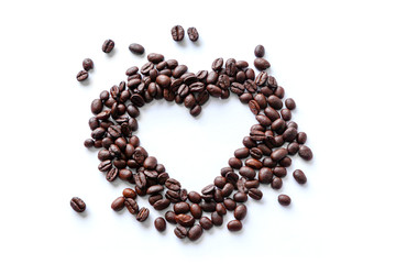 Love of Coffee Beans in the Shape of a Heart Isolated on White