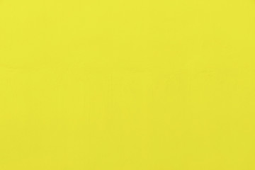 Abstract background from yellow concrete wall. Free space for text.