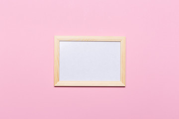 blank frame on a pastel pink background