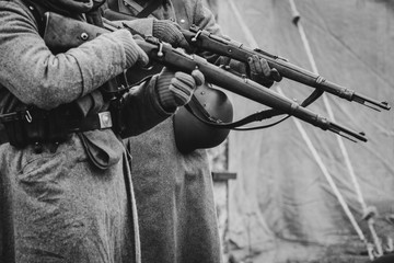 Two German soldiers of the Second World War with rifles in their hands ready to fire. Black and white photo