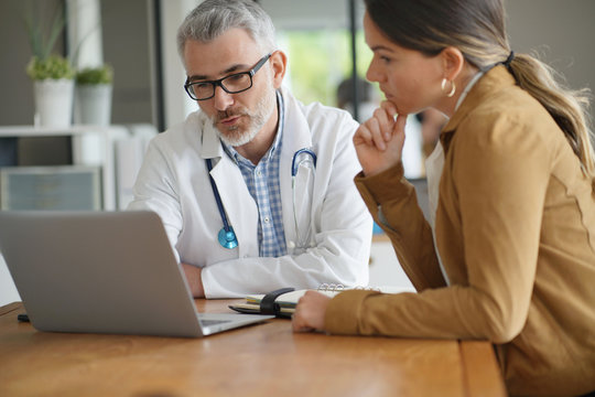 Woman having medical appointment with doctor in hospital