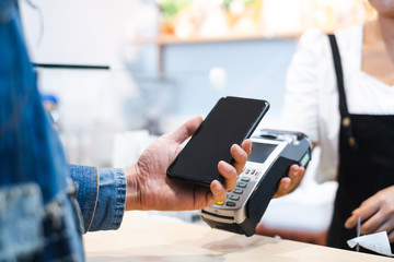 Customer using credit cart for payment to owner at cafe restaurant, cashless technology and credit card payment concept - fototapety na wymiar