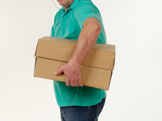man holds in his hands a big box on a white background.