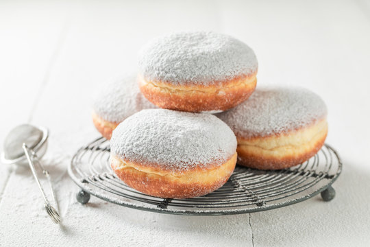 Delicious and sweet donuts with white icing
