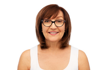 beauty, vision and old people concept - portrait of smiling senior woman in glasses over white background