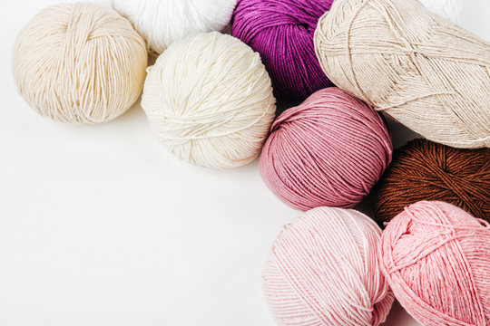 Colorful yarn for knitting on White background.