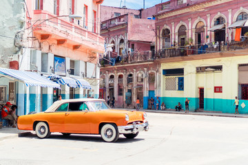Foto auf Acrylglas Havanna View of yellow classic vintage car in Old Havana, Cuba