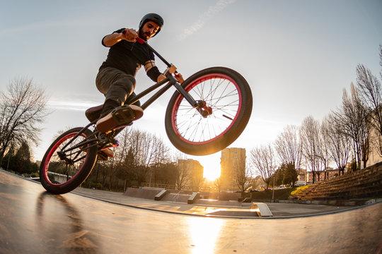 BMX trick in a wooden ramp