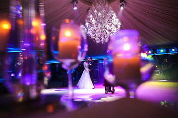 happy gorgeous wedding couple having first dance at wedding party in restaurant reception